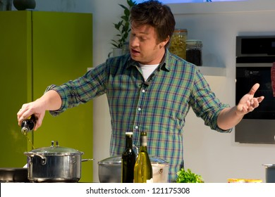 LONDON, UK - DEC 7: Jamie Oliver conducts a cooking demonstration at the Excel center in London, Friday, December 7, 2012 in London, UK