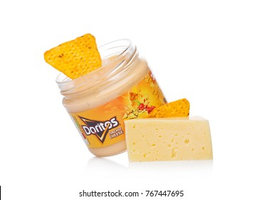 LONDON, UK - DECEMBER 01, 2017: Doritos tortilla chips with Nacho Cheese Dip with cheese and nachos on white background