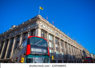 London, UK - December 04, 2018 - Selfridges department stores with a passing double-decker bus in the foreground