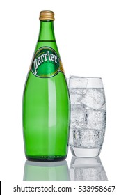 LONDON, UK - DECEMBER 06, 2016: Bottle and glass with ice of Perrier sparkling water. Perrier is a French brand of natural bottled mineral water sold worldwide.