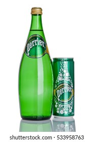 LONDON, UK - DECEMBER 06, 2016: Bottle and tin of Perrier sparkling water. Perrier is a French brand of natural bottled mineral water sold worldwide.