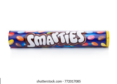 LONDON, UK -DECEMBER 07, 2017: Smarties chocolate sweets tube on white background. Manufactured by Nestle.