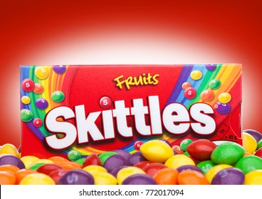 LONDON, UK -DECEMBER 07, 2017: Skittles Candy Pack on red background. Skittles is a brand of fruit flavoured sweets.