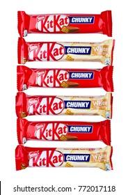 LONDON, UK -DECEMBER 07, 2017: Kit Kat chunky chocolate bar white chocolate on white background. Bars Kit Kat is produced by Nestle company.