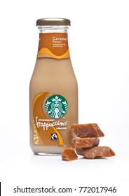 LONDON, UK -DECEMBER 07, 2017: Glass bottle of Starbucks frappuccino coffee drink with caramel on white background. Seattle based Starbucks is the largest coffeehouse company in the world.
