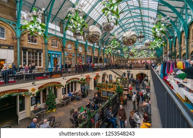 LONDON, UK - DECEMBER 08, 2018: Apple Market in Covent Garden decorated for Christmas. The Market is popular with tourists and a great place to find souvenirs, jewellery, artworks and collectables