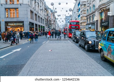 LONDON, UK - DECEMBER 08, 2018: Shoppers hunt for bargains in shops on London's Oxford Street in run up to Christmas.