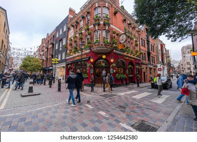 LONDON, UK - DECEMBER 08, 2018: Christmas street decorations at Seven Dials in Covent Garden area attract thousands of people during the festive season and are a major tourist attraction in London.
