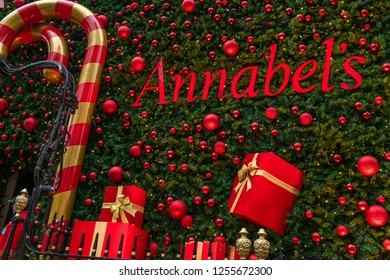 LONDON, UK - DECEMBER 08, 2018: Famous private club Annabel's in Berkeley Square, London decorates entrance into the building with a giant Christmas tree