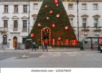 LONDON, UK - DECEMBER 08, 2018: Famous private Annabel's Club in Berkeley Square, London decorates entrance into the building with a giant Christmas tree