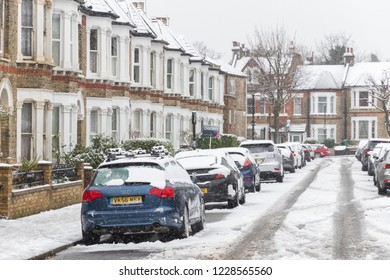 London, UK - December 10, 2017 - London street covered in winter snow around West Hampstead