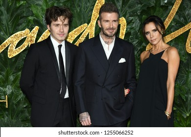 LONDON, UK. December 10, 2018: Brooklyn Beckham, David Beckham & Victoria Beckham at The Fashion Awards 2018 at the Royal Albert Hall, London.