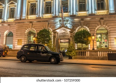 LONDON, UK - DECEMBER 12, 2016: London Taxi parked at the entrance to Sofitel London St James hotel. Christmas 2016