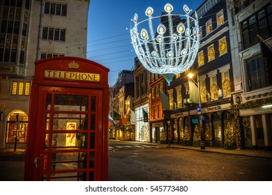 LONDON, UK - DECEMBER 12, 2016: Red Telephone Box at New Bond Street with Christmas decorations