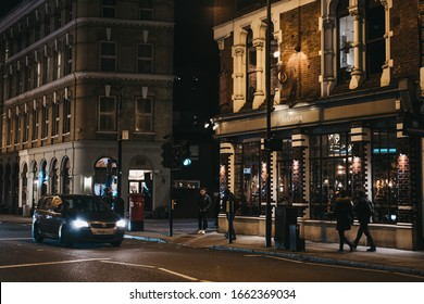 London, UK - December 14, 2019: Facade of The Culpeper pub in Shoreditch, a trendy area of Londons East End that is home to an array of markets, bars and restaurants. In the evening, people walk past.