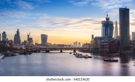 London, UK - December 15, 2016:  London cityscape and skyline at sunrise from Waterloo bridge