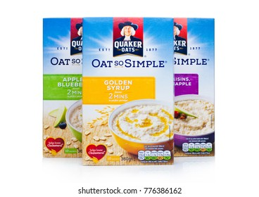 LONDON, UK - DECEMBER 15, 2017: Boxes of Quaker Oats porridge with golden syrup and fruits on white background. It has been owned by PepsiCo since 2001.