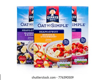 LONDON, UK - DECEMBER 15, 2017: Boxes of Quaker Oats porridge with and fruits on white background. It has been owned by PepsiCo since 2001.
