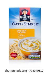 LONDON, UK - DECEMBER 15, 2017: Box of Quaker Oats porridge with golden syrup on white background. It has been owned by PepsiCo since 2001.