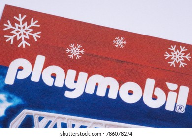 LONDON, UK - DECEMBER 18TH 2017: The Playmobil logo printed in a Tesco toys catalogue, on 18th December 2017.  Playmobil is a brand of toys produced by the Brandstatter Group.