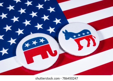 LONDON, UK - DECEMBER 18TH 2017: The Elephant symbol of the Republican Party and the Donkey symbol of the Democratic Party, with the American flag behind, on 18th December 2017.