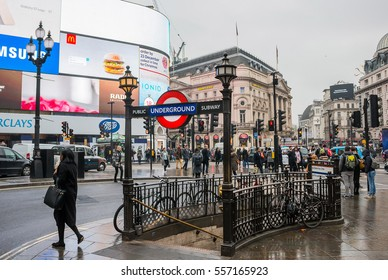 LONDON UK - DECEMBER 19 2016: Piccadilly Circus, entrance/exit to the underground in a cloudy rainy day