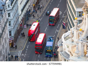London, UK - December 19, 2016: Aerial view of the City of London road with double decker buses and lots of office workers walking on the street.