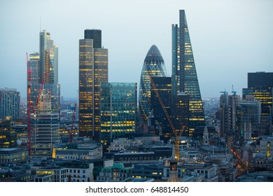 London, UK - December 19, 2016: City of London business area view at night. City of London the leading financial centre in the Europe.