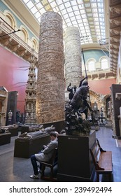 LONDON, UK - DECEMBER 20: The Cast Courts at the Victoria and Albert Museum. December 20, 2014 in London. The room includes a plaster copy of Trajan's column, divided in 2 sections due to its height.