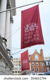 LONDON, UK - DECEMBER 20: Large red banners in front of the Royal Opera House, depicting the Royal coat of arms. December 20, 2015 in London.
