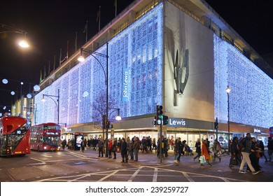 LONDON, UK - DECEMBER 20: Nighttime shot of John Lewis department store exterior in busy Oxford  street with wall of lights as part of its Christmas decorations. December 20, 2014 in London.