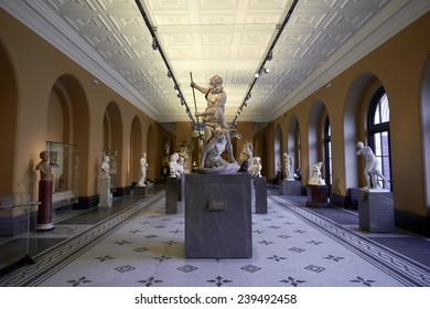 LONDON, UK - DECEMBER 20: Victoria and Albert museum's Medieval and Renaissance room, with statue of Neptune and Triton in the centre. December 20, 2014 in London.