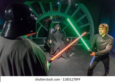 London, UK - December 2015: Madame Tussaud's Waxwork Museum, Star Wars display, Luke Skywalker fights Darth Vader with glowing lightsabers, while being watched by the Emperor