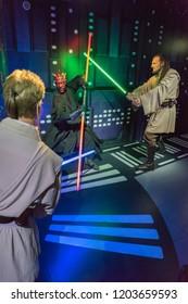 London, UK - December 2015: Madame Tussaud's Waxwork Museum, Star Wars display, Darth Maul fights Obi Wan Kenobi and Qui-Gon Jinn, Realistic lifelike models