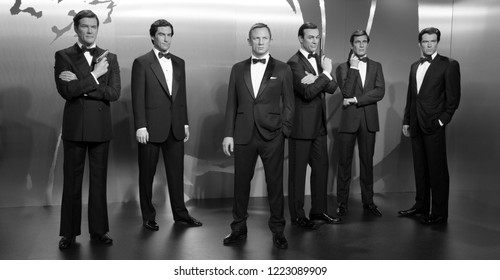London, UK - December 2015: Madame Tussaud's Waxwork Museum, all the James Bond Actors on Display, Black and White