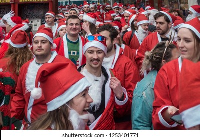 London, UK - December 2018 : Group of people dressed in santa outfits and taking part in a themed SantaCon event