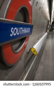 London UK, December 2018. Platform at Southwark Underground Station, London showing station name in TFL roundel.