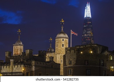 LONDON, UK - DECEMBER 20TH 2016: A view at dusk of the Tower of London with the Shard skyscraper in the background in London, on 20th December 2016.