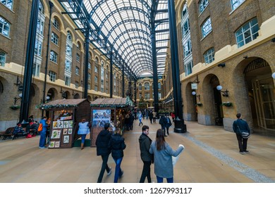 LONDON, UK - DECEMBER 22, 2018: Shops, cafes and restaurants at Hay's Galleria in central London enjoy the festive spirit with their huge Christmas tree decorated with baubles and lights