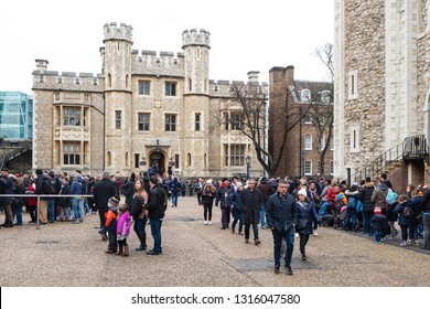 LONDON, UK - DECEMBER 28, 2018: A large queue of people waiting to see the famous Crown Jewels of England, in display at the Jewels House, in the Tower of London, in London, United Kingdom