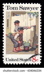 London, UK, December 30 2010 - Vintage 1972 United States of America cancelled postage stamp showing an image of two boys painting a fence from Mark Twain's novel Tom Sawyer