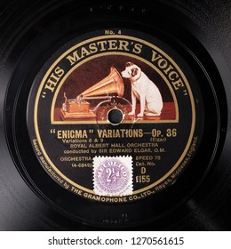 "LONDON, UK - December 30 2018: ""His Master's Voice"" HMV label on 78RPM record of Enigma Variations by Edward Elgar recorded 1926, with logo by Francis Barraud of white dog listening to phonograph horn"