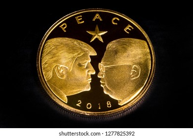 London, UK - December 4th 2018: A coin commemorating the peace summit on 12th June 2018 between US President Donald Trump and North Korean leader Kim Jong-un.