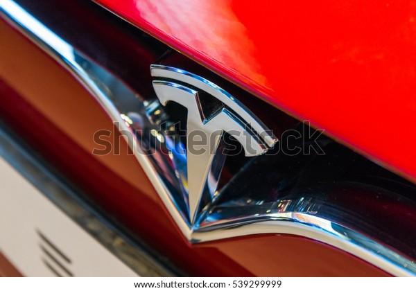 LONDON, UK - December 6, 2016 - Red Tesla S model in dealership in London.