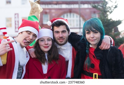 LONDON, UK - DECEMBER 6: Parade of Santa Claus impersonators on the streets of London on December 6, 2014