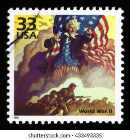 London, UK, December 7 2010 - Vintage 1999 United States of America cancelled postage stamp of World War Two with soldiers and Uncle Sam holding the Stars and Stripes