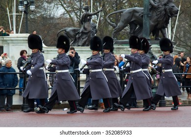 LONDON, UK - December 7, 2015:  British Royal guards performing the Changing of the Guard at Buckingham Palace in London  on December 7, 2015.