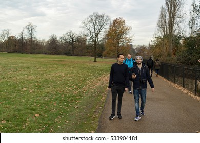 London, UK - December 8th, 2016: Tourists walking in Hyde Park.