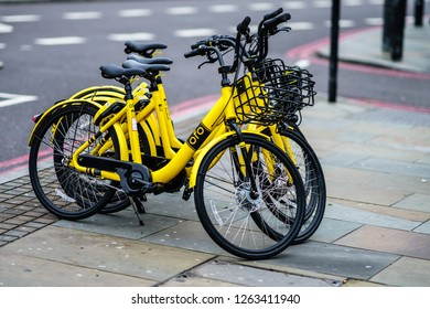 London, UK - December 8th, 2018 : OFO yellow bike use by mobile app parked in Angle, London