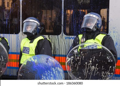 LONDON, UK - DECEMBER 9, 2010: Paint splattered riot police protect Parliament during student protests.